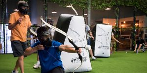Players shooting bows and arrows at the Archery Games Calgary facility