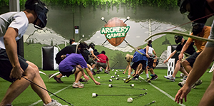 People grabbing arrows at Archery Games Calgary